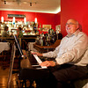 Pianist LeMoyne Smith plays for dinner customers at Louis Le Francais in downtown New Albany on Thursday evening. Staff photo by Christopher Fryer
