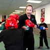 Terry Middleton spars with Todd Ross, of New Albany, during black belt class at Middleton's martial arts studio in downtown New Albany on Wednesday evening. Middleton offers training in boxing, kickboxing, mixed martial arts, and karate and has been in business for 40 years. Staff photo by Christopher Fryer