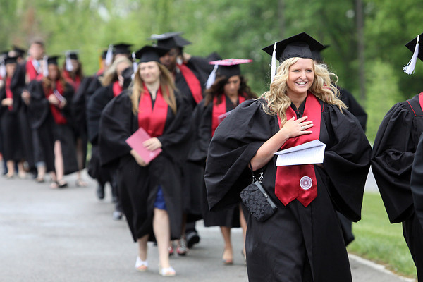 Students file into the Indiana University Southeast Activities Building on Monday afternoon for the 45th commencement. Staff photo by C.E. Branham