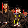 Munkhtsetseg Nandigjav looks into the crowd during the Purdue University College of Technology's commencement ceremony at the Ogle Center at IU Southeast on Thursday. Purdue graduated 48 students in the class of 2012. Staff photo by Jerod Clapp
