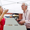 Amanda Smart, left, of Jeffersonville, laughs while showing Melvin Jensen, of Georgetown, a piece of debris she found shuffling through change as they both volunteer during the annual Pennies from Heaven Fundraiser at Hosparus in New Albany on Wednesday afternoon. Funds raised through the collection will be used to benefit Hosparus patients and families in Clark, Crawford, Floyd, Harrison, Scott, and Washington counties. Staff photo by Christopher Fryer
