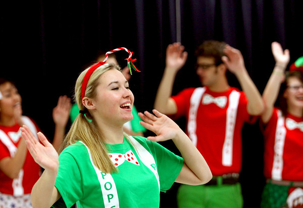 Providence High School senior Mandy Ross and other members of the Popcorn Players perform Saturday morning at the school's annual breakfast with Santa. Staff photo by C.E. Branham