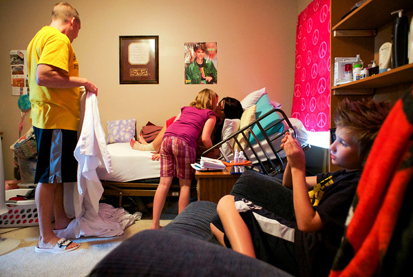 Mia Gilles kisses her mother Trish while she gets in bed for the evening at Trish's mother's home in Sellersburg. The family is still staying in Sellersburg while their Henryville home is being rebuilt after it was destroyed during the March 2 tornadoes. Staff photo by Christopher Fryer