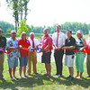 Jeffersonville City Council members Dennis Julius, Mike Smith. Lisa Gill, Zach Payne, Matt Owen and Connie Sellers join former Jeffersonville Mayor Tom Galligan, Jeffersonville Mayor Mike Moore and Jack Vissing in cutting the ribbon on the newly designed Richard L. Vissing Park. Staff photo by C.E. Branham