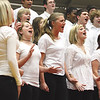 "The New Albany High School Acappella Singers, under the direction of Linda DeRungs, perform ""Heaven"" by Dr. Roosevelt Escalante at the 74th annual Ohio Valley Choral Festival.  The event was held Thursday evening at Jeffersonville High School and featured more than 300 singers from six southern Indiana schools.  Staff photo by C.E. Branham"