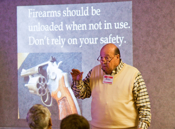 Volunteer instructor Tony Johnson, of Jeffersonville, talks about firearm safety during a gun safety seminar at the Clark County Casting and Conservation Club on Saturday afternoon. Staff photo by Christopher Fryer