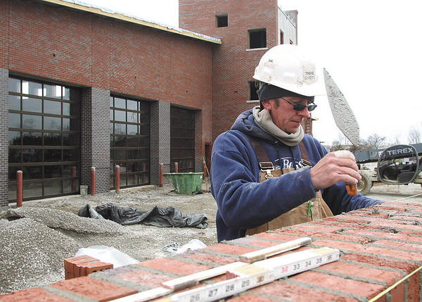 Doug Watkins with Arnold Masonry works outside the new Clarksville Fire Department headquarters late last week.  The new station is expected to be operational by April.  Staff photo by C.E. Branham