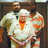Nettie Luckett, of New Albany, is escorted to the Floyd County Circuit Court for a hearing at the City-County Building in downtown New Albany on Thursday afternoon. Luckett was charged with the murder of her son-in-law, Douglas Randolph, of Louisville, in August of last year. Staff photo by Christopher Fryer