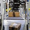 Products move down a conveyor belt after being labeled during the packing process at the Amazon Fulfillment Center, 900 Patrol Road, in Jeffersonville on Thursday afternoon. Staff photo by Christopher Fryer