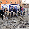 Mayor Jeff Gahan, center, and members of the New Albany Bicentennial Commission participate in a ground breaking ceremony for the new Bicentennial Park at the corner of Spring and Pearl Streets in downtown New Albany on Tuesday evening. The park is scheduled to open in April of 2013. Staff photo by Christopher Fryer