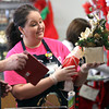 Clark Memorial Hospital volunteer Shawna Nally helped stock shelves with Christmas items at the Goodwill store in New Albany as part of the hospital's morning of service. Staff photo by C.E. Branham