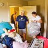 Jeff Pace, Indianapolis, helps his daughter Haley move into her apartment in the Meadow Lodge at Indiana University Southeast in New Albany on Thursday morning. Haley is one of 265 new students that are signed up to live in on-campus housing. Staff photo by Christopher Fryer