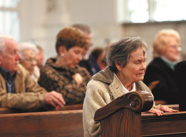 Ann Huffine prays while attending Ash Wednesday mass at St. Augustine Catholic Church in Jeffersonville.  Ash Wednesday marks the beginning of the Lenten season.  Staff photo by C.E. Branham