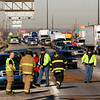 Emergency officials work the scene of a four vehicle, injury accident on Interstate 65 Southbound near the Kennedy Bridge in Jeffersonville on Friday. A separate accident occurred near the same location involving three other vehicles. Both accidents occurred at about 11:30 a.m. Staff photo by Christopher