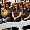 Ebony Carson holds her son Cornell next to Kara Mellick and Allison Ellis, right, during the closing prayer at a press conference to kick off the Partnership to Eliminate Child Abuse awareness campaign in the lobby of Kosair Children's Hospital in Louisville on Wednesday morning. Carson, Mellick and Ellis all spoke at the event and shared their past experiences with child abuse. Staff photo by Christopher Fryer