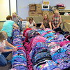 Hope Southern Indiana volunteers sort through more than 2,600 backpacks which will be given away to students who qualify for free lunch during school registration next week. The backpacks are stuffed with school supplies. The backpacks and supplies were donated by are churches and individuals according to Carol Kannapel, project coordinator for Hope, formerly Interfaith Community Council, located at 1200 Bono Road in New Albany. STAFF PHOTO BY CHRIS MORRIS