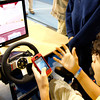 Garrett Woods, eighth-grader at Charlestown Middle School, is shocked when he collides with a truck after checking a text message in a texting and driving simulator. Indiana SADD brought a few simulations for texting and impaired driving to warn students of those dangers. Staff photo by Jerod Clapp