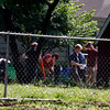 Investigators with the New Albany Police Department and forensic anthropoligists from the University of Indianapolis dig in the back yard of William Clyde Gibson — who is charged with the murder of two women. The remains of another woman, Stephanie Kirk, 35, were found buried in Gibson's back yard last month. Staff photo by Jerod Clapp