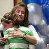 Pleasant Ridge Elementary School fifth-grade teacher Mrs. Crystal Merrifield hugs former student Gabrielle Gagnon at a ceremony Wednesday at which Merrifield was named the WHAS 11 ExCEL award winner and Greater Clark Teacher of the Year. Staff photo by C.E. Branham