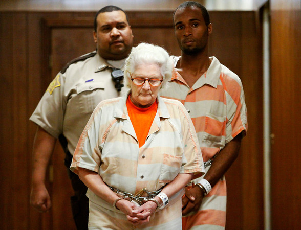 Nettie Luckett, of New Albany, is escorted to the Floyd County Circuit Court for a hearing at the City-County Building in downtown New Albany on Thursday afternoon. Luckett was arrested for the murder of her son-in-law, Douglas Randolph, of Louisville, in August of last year. Staff photo by Christopher Fryer
