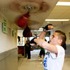 Mason Brown, of New Albany, works out with a speed bag in the boxing gym of Terry Middleton's martial arts school in downtown New Albany on Wednesday evening. Middleton offers training in boxing, kickboxing, mixed martial arts, and karate and has been in business for 40 years. Staff photo by Christopher Fryer