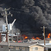 Several regional fire departments battle a huge fire Saturday evening at Riverside/QRS Recycling in New Albany. Staff photo by C.E. Branham