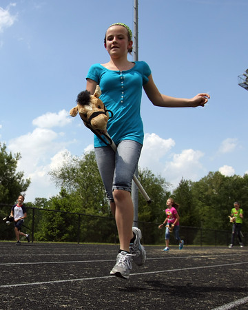 Jenna Nicholas, a fifth-grader at Highland Hills Middle School, runs in the school's inagural Fifth Grade Derby. The event was part of the school's series of lessons to keep them engaged for the last part of the school year. Students studied the measurements and distance of the track in science classes and the history of the Kentucky Derby in Social Studies. Staff photo by Jerod Clapp