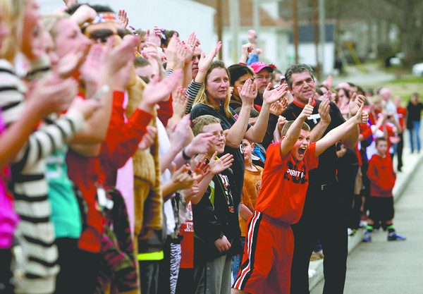 Hundreds of fans lined up to send off the Borden High School basketball team Friday night. Borden plays in the semistate at Seymour Saturday afternoon. Staff photo by C.E. Branham
