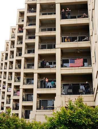 Spectators gather on the balconies of the Harbours Condominiums in Jeffersonville during Thunder Over Louisville on Saturday evening. Staff photo by Christopher Fryer