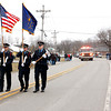 A color guard with the Monroe Township Fire Department leads off a parade on Saturday for the anniversary of the tornado that struck Henryville, Ind. on March 2, 2012. Residents lined the street for the parade in spite of cold temperatures and snow. Staff photo by Jerod Clapp