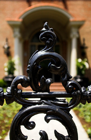 Ornate patterns decorate the iron fence in front of the Ricke home located at the corner of Elm and 10th streets in New Albany on Wednesday afternoon. Larry Ricke and his wife Ann started restoring the historic house in 2006 and moved into the residence in September of 2011. Staff photo by Christopher Fryer