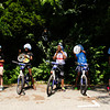 Participants put on their helmets before riding through the bicycle safety rodeo course at the Griffin Center on Friday afternoon in New Albany. About 20 participants from the Riverside, Parkview and Griffin Street recreation centers learned about traffic rules and general bicycle safety in the Kosair Children's Hospital event through the New Albany Department of Parks and Recreation. Staff photo by Christopher Fryer