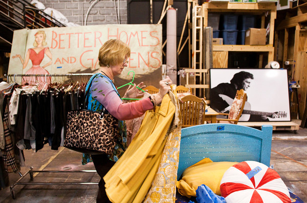Norma Pendleton, Louisville, shops for clothing items during the Derby Dinner Playhouse costume and scenery prop sale in Clarksville on Saturday morning. Staff photo by Christopher Fryer