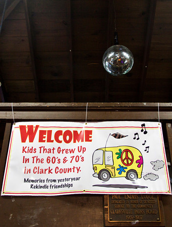 A disco ball and event banner hang overhead during the first Kids That Grew Up In The 60's and 70's  In Clark County reunion at Lapping Park in Clarksville on Saturday afternoon. Staff photo by Christopher Fryer