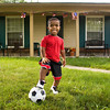 Amon Armour, 7, stands in front of his family's Jeffersonville home on Thursday afternoon. Armour was born with achondroplasia, which is a form of dwarfism. He will be competing in this year's World Dwarf Games at Michigan State University in football, track and field, basketball, floor hockey, and soccer. Staff photo by Christopher Fryer