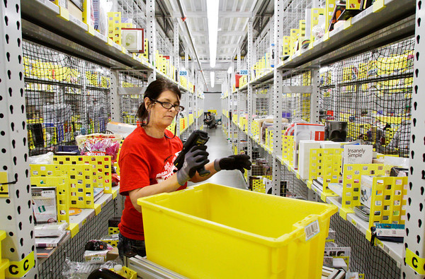 Picker Tina Gritton, of Louisville, works in the pick module at the Amazon Fulfillment Center, 900 Patrol Road, in Jeffersonville on Thursday afternoon. Staff photo by Christopher Fryer