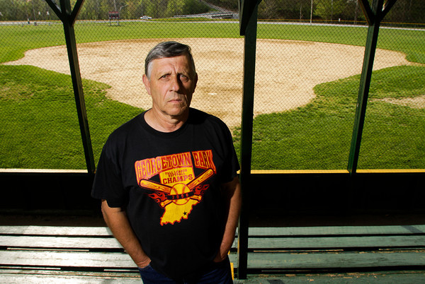 Billy Haller, of Georgetown, stands on the bleachers at the Georgetown Park softball field on Tuesday morning. Haller is the former league director and caretaker of the field. Staff photo by Christopher Fryer