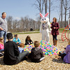 Sara Schutz, director of special events and RiverStage for Jeffersonville's Parks Department, helps the Easter bunny give out egg hunting tips in Vissing Park on Thursday afternoon in Jeffersonville. There will be a flashlight Easter egg hunt at the park on Saturday night, where 5,000 eggs will be hidden. Staff photo by Christopher Fryer