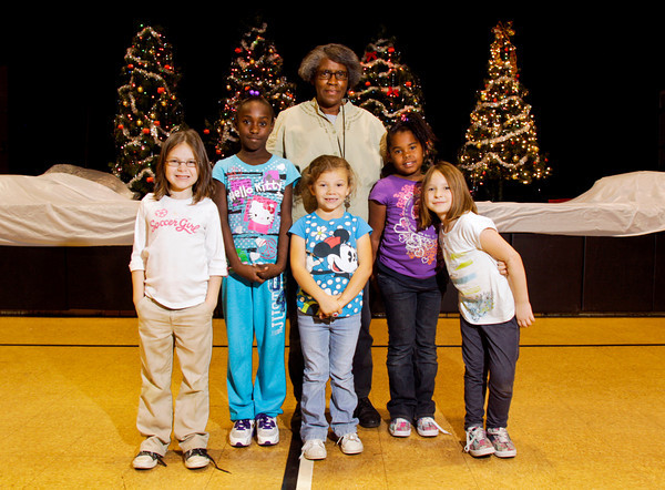 New Albany-Floyd County Parks Department recreation director Kathy Wilkerson, center, stands with, from left, Marissa Reum, 6, Daisha Morris, 9, Misty Tharp, 6, Dakila Stockton, 8, and Constance Eagle, 7, in the gymnasium at the Griffin Center in New Albany on Wednesday afternoon. Beginning Jan. 1, Wilkerson will be the interim superintendent for the New Albany Parks Department. Staff photo by Christopher Fryer