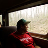 Mark Hays, of Scottsburg, looks out the window as he rides in a passenger car on the Norfolk Southern Operation Lifesaver Whistle-Stop Train during a train tour to promote highway-rail and pedestrian safety on Friday. Staff photo by Christopher Fryer