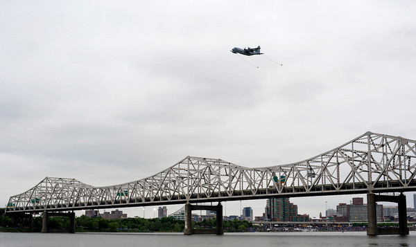 An aircraft flies over Interstate 65 above the Ohio River during the Thunder Over Louisville air show on Saturday evening. Staff photo by Christopher Fryer
