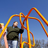Volunteer Jason Clopton, of New Albany, applies a fresh coat of paint to a piece of playground equipment during the cleanup day at Sam Peden Community Park in New Albany on Saturday morning. Staff photo by Christopher Fryer