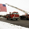 "New Albany Fire Department Engine 8 carries the casket of former Chief Robert ""Bob"" Herman to his final resting place at Kraft-Graceland Memorial Park in New Albany on Monday. Herman served with the department for more than 20 years. Staff photo by Jerod Clapp"