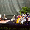 Other religious and community leaders look on as the Dalai Lama addresses questions from the audience during a public talk that focused on compassion and its importance in today's world at the KFC Yum! Center in Louisville on Sunday afternoon. Staff photo by Christopher Fryer
