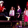 """Remi Maxwell, senior, Catie King, junior, Arielle Conrad, freshman and Samantha Couch, sophomore, act out a scene from Silver Creek High School's production of """"Grease."""" The show opens tonight at 7:30 p.m. Staff photo by Jerod Clapp"""
