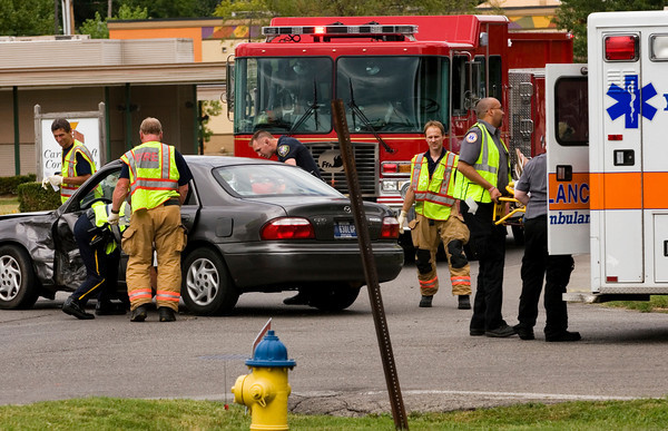 Emergency crews work the scene of an accident involving two vehicles and two people at the intersection of Terry Lane and Charlestown Road on Friday afternoon in New Albany. Both drivers were transported to Floyd Memorial Hospital with injuries. Staff photo by Christopher Fryer