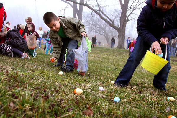 Dozens of kids fan out over Colgate Park to collect hundreds of eggs during the annual Clarksville Parks Department Easter egg hunt. Staff photo by C.E. Branham