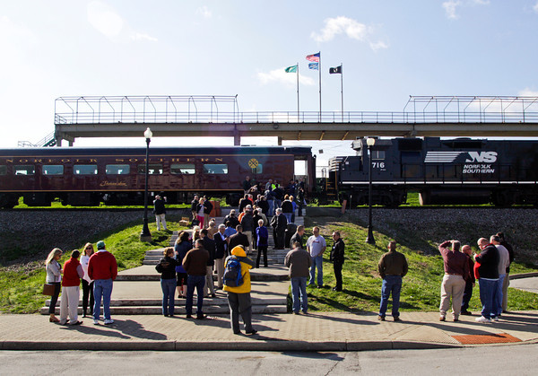 Passengers wait to board the Norfolk Southern Operation Lifesaver Whistle-Stop Train in New Albany on the way to Huntingburg during a train tour to promote highway-rail and pedestrian safety on Friday. Staff photo by Christopher Fryer