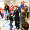 Participants celebrate after their team's victory during the marshmallow pass-along event at the Gobbler Games in the Clarksville Community Center on Saturday morning. About 50 children between the ages of five and 12 participated in other games and crafts at the annual event put on by the Clarksville Parks Department and the Optimist Club of Clarksville. Staff photo by Christopher Fryer