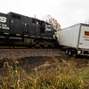 A tractor-trailor and a freight train sit on the tracks after the two collided at the Old Georgetown Road railroad crossing near the intersection of Ind. 64 and Oakes Road in Georgetown on Friday afternoon. No one was injured and no hazardous material was released. Staff photo by Christopher Fryer